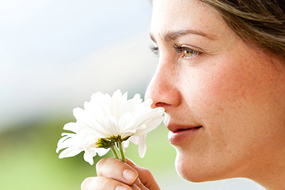 woman-smelling-flower_400px